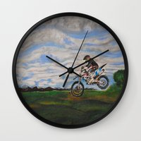 moto Wall Clocks featuring Moto Jump  by Chloe Metcalfe