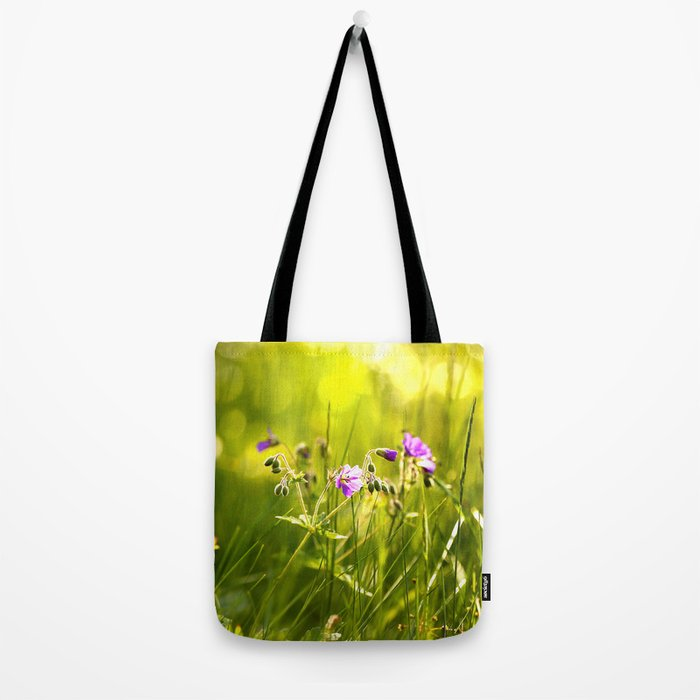 Beautiful meadow flowers - geranium on a sunny day - brilliant bright colors Tote Bag