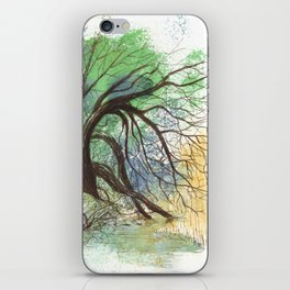 Trees bending over the water iPhone Skin