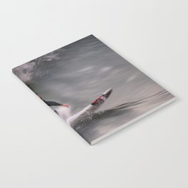 Surfer riding a wave Notebook