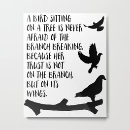 A bird sitting on a tree Metal Print
