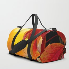 Autumn red vine leaves and yellow background Duffle Bag