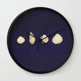 seashells on a dark background Wall Clock