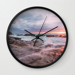 Rocky beach at sunset Wall Clock