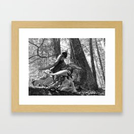 Knight riding through the forest Framed Art Print