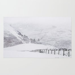 Skiddaw, mountainside covered in snow. Latrigg, Cumbria, UK. Rug