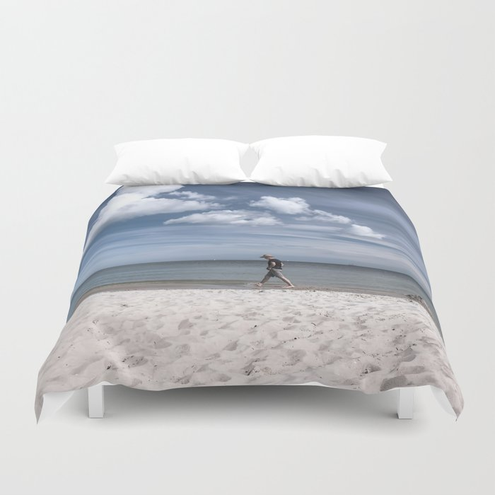 Lonely man at the beach Duvet Cover