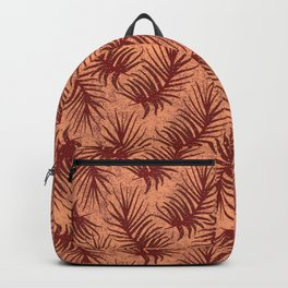 Red-brown leaves on a mottled background. Backpack