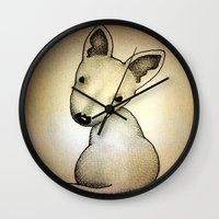 bull terrier Wall Clocks featuring Bull Terrier Pup by Caroline Blicq