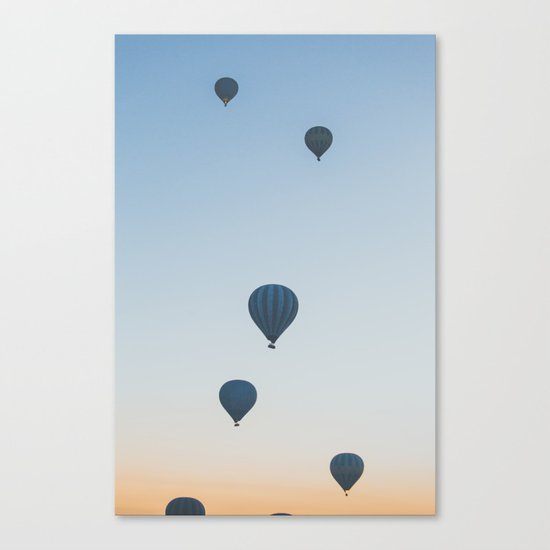 balloons over the desert Canvas Print