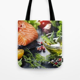 Delicious  portion of fresh salmon fillet  with aromatic herbs, spices and vegetables Tote Bag