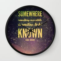 carl sagan Wall Clocks featuring Space Exploration (Carl Sagan Quote) by taudalpoiart
