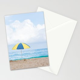 Beach umbrella in beautiful scenery with sand, blue sea and cloudy sky in Trindade, Paraty, Brazil. Stationery Cards