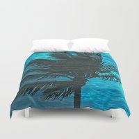 swimming Duvet Covers featuring Swimming Palm by Catspaws