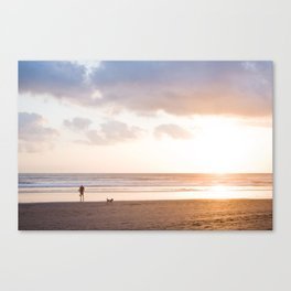 Sunset at Beach with Surfer Man Canvas Print
