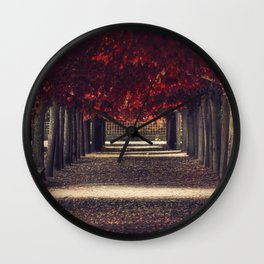 Red colors of autumn, surreal photo, red trees, alley in a park Wall Clock