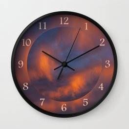 orange light on cirrus clouds and blue sky Wall Clock