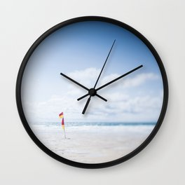 tilt and shift Lifeguard flag, Fistral Beach, Cornwall Wall Clock