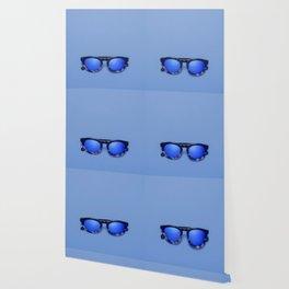 Blue Lens Sunglasses on a Blue background Wallpaper