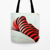 socks Tote Bags featuring Stripy socks by Innershadow Photography