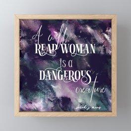 A well read woman Framed Mini Art Print