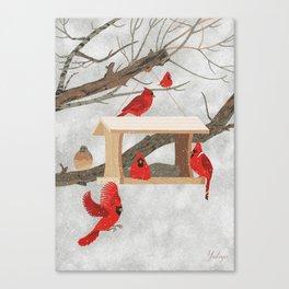 Cardinals at bird feeder Canvas Print