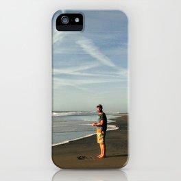 boy on black sand beach in new zealand iPhone Case