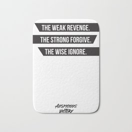 The weak revenge. The strong forgive. The wise ignore. Black Print. Bath Mat