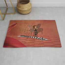 Cute fairy dancing on a piano Rug