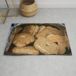 Homemade biscuits in aluminum paper bag Rug