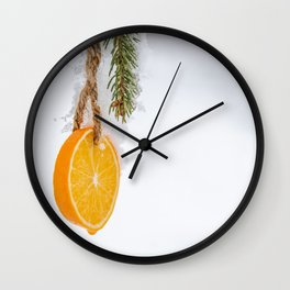 Cold frosty Orange Slice hanging in a tree for the holidays Wall Clock