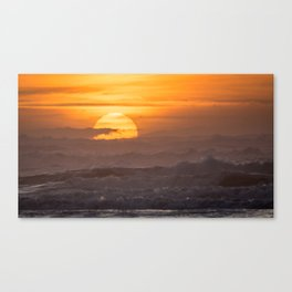 Close-up of Sun Settings Over Ocean Waves Canvas Print