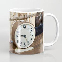 Old books on shelf and alarm clock Coffee Mug