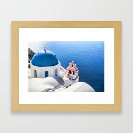 Blue and white church in Oia village, Santorini, Greece Framed Art Print