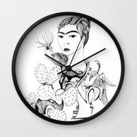 frida kahlo Wall Clocks featuring Frida Kahlo by eva vasari