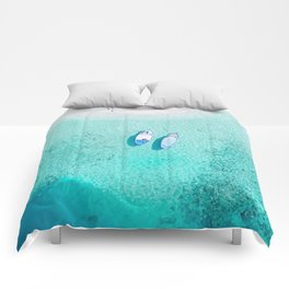 boats on the beach Comforters