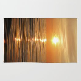 Sun setting over calm waters Rug