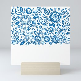 Beautiful folk art floral ornament with blue flowers on white background Mini Art Print