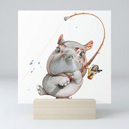 A hippopotamus fishing Mini Art Print