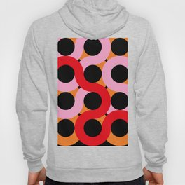 Black circles being surrounded by red and pink curves. All happening in an orange landscape. Hoody