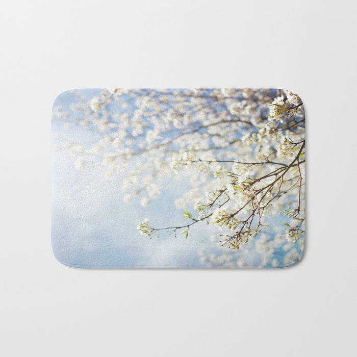White Flowers Against the Sky Bath Mat