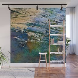 Colored sea waves licking the rock Wall Mural