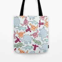 dinosaurs Tote Bags featuring Dinosaurs  by MadexDesigns