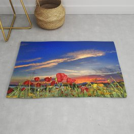 Poppies at sunset Rug
