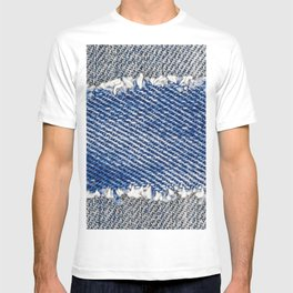 Denim frame. Ripped denim fabric with fringe edge on bleached denim background, text place, copy space. Worn Jeans Casual Double Color patch. Classic blue denim pattern texture  T-shirt