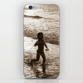 Little surfer girl runs in the waves with her bodyboard iPhone Skin