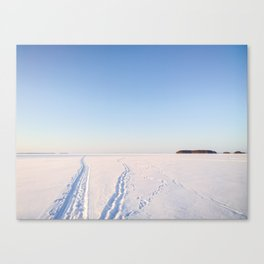 Footsteps in Snow on Lake Ice Canvas Print