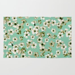 Small flowers on green wall Rug