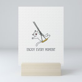 Enjoy every moment. Doodle vector illustration of funny white cat swinging on a rope swing Mini Art Print