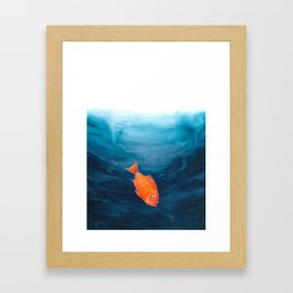 A lonely red fish in the deep sea Framed Art Print